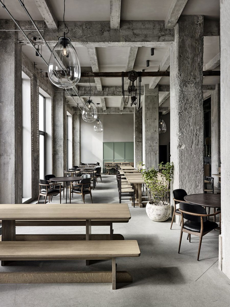 Inside the 108 Restaurant, Copenhagen with its industrial warehouse shell and minimal Nordic style.