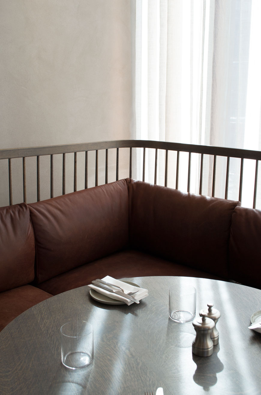 Soft, diffused light on the wrap around wooden slatted, leather breakfast bench in the brasserie at The Stratford.