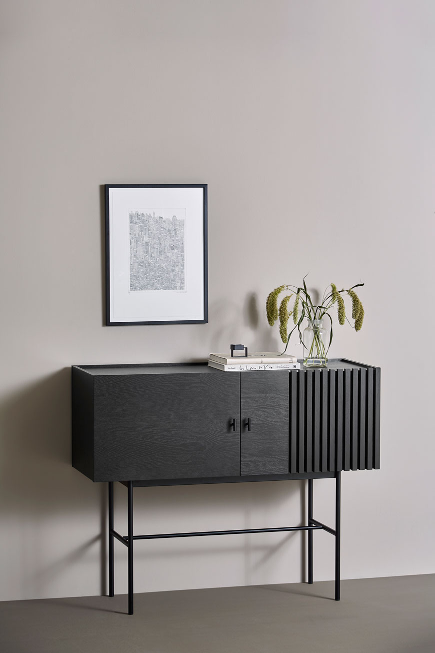 The one piece of furniture that works really hard in the dining room is a sideboard like this one in black oak, designed by Woud and available at Pepper Sq.