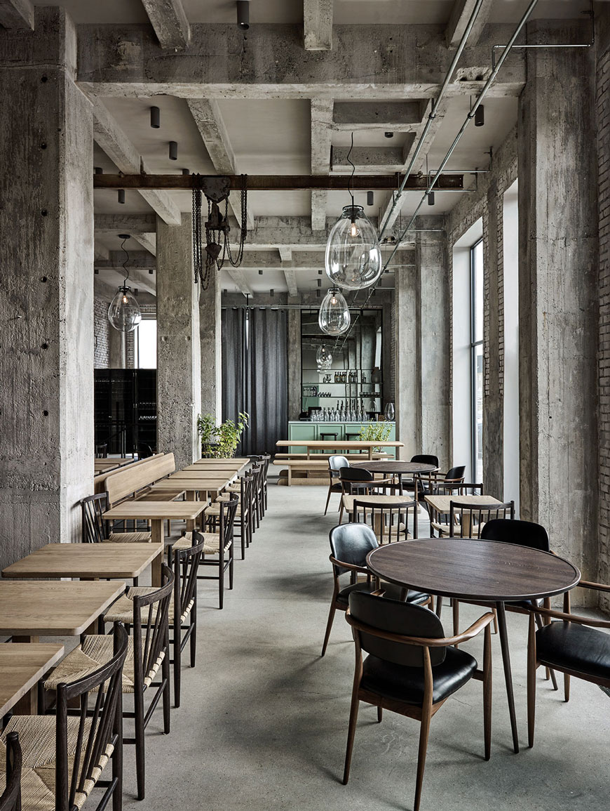 Restaurant 108, the sister site to NOMA, designed by Space Copenhagen within an industrial concrete shell warehouse.