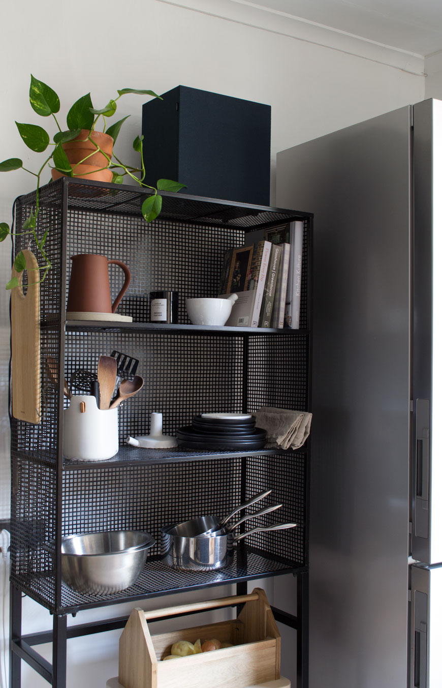 A freestanding wire unit is a perfect example of how to use small kitchen storage ideas to maximise space.