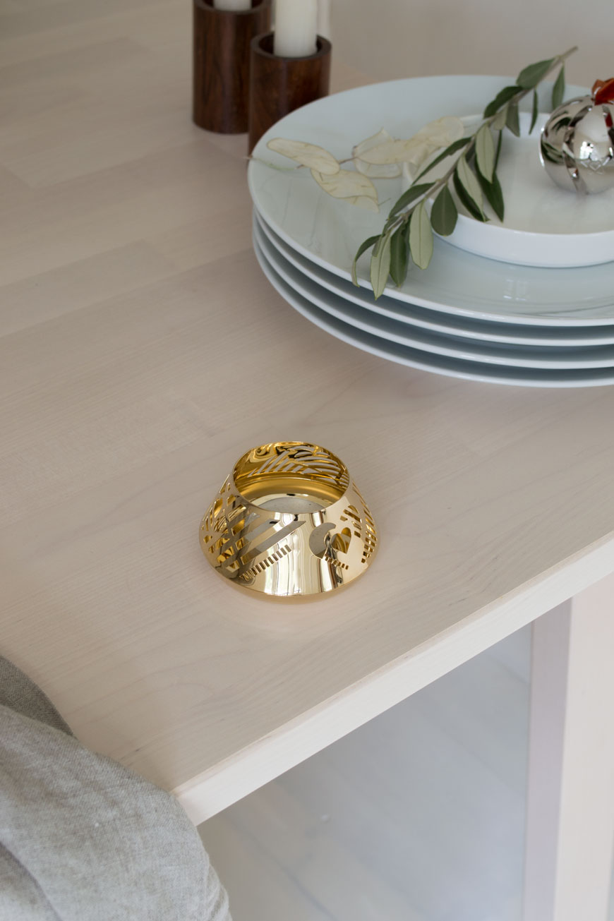 A touch of festive sparkle, a simple heart tea light holder designed by Georg Jensen.