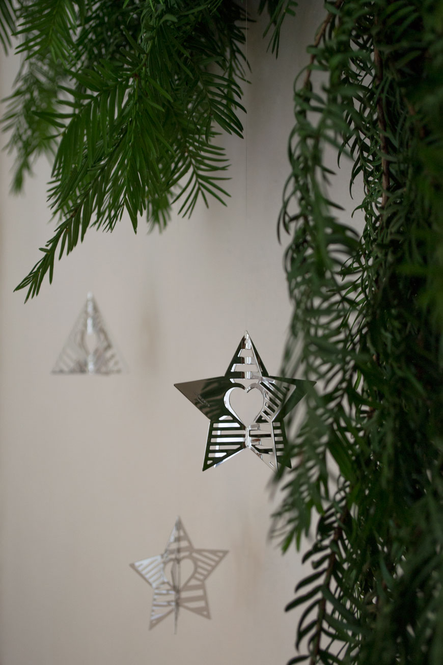 A close up of the Palladium plated Star and Tree ornaments from the Georg Jensen Christmas Collectibles collection 2019