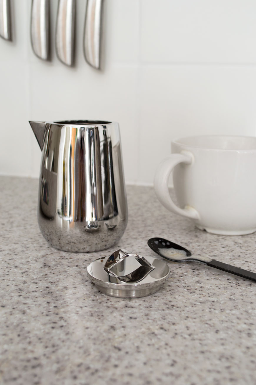 A sleek and minimal milk jug, from the new Georg Jensen Helix collection in a bright, minimal Scandi kitchen.