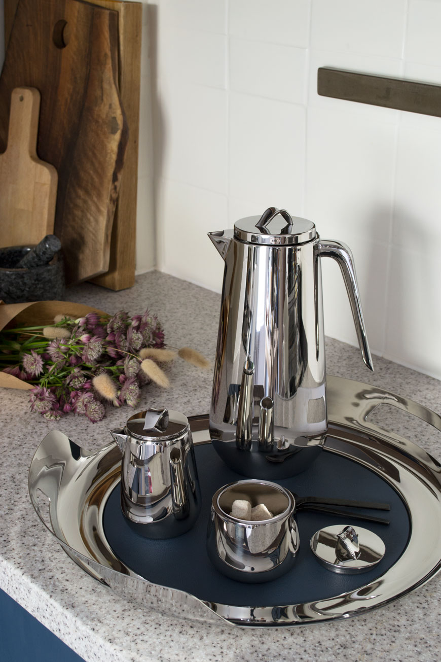 The Helix collection, a new stainless steel tea and coffee service looks at home in a blue and white Scandi kitchen.