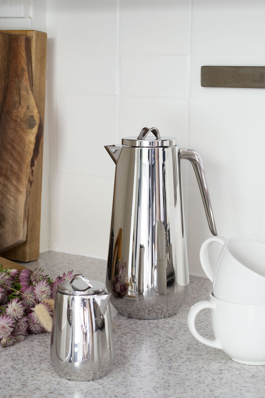 The Helix collection from Georg Jensen, designed in stainless steel by Bernadotte and Kylberg styled in a bright, white kitchen.