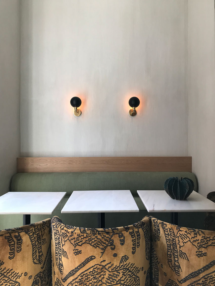 Textured pale plaster walls provide a minimal, Scandinavian backdrop for sumptous velvet Tearoom chairs by MENU inside the new restaurant at The Audo.