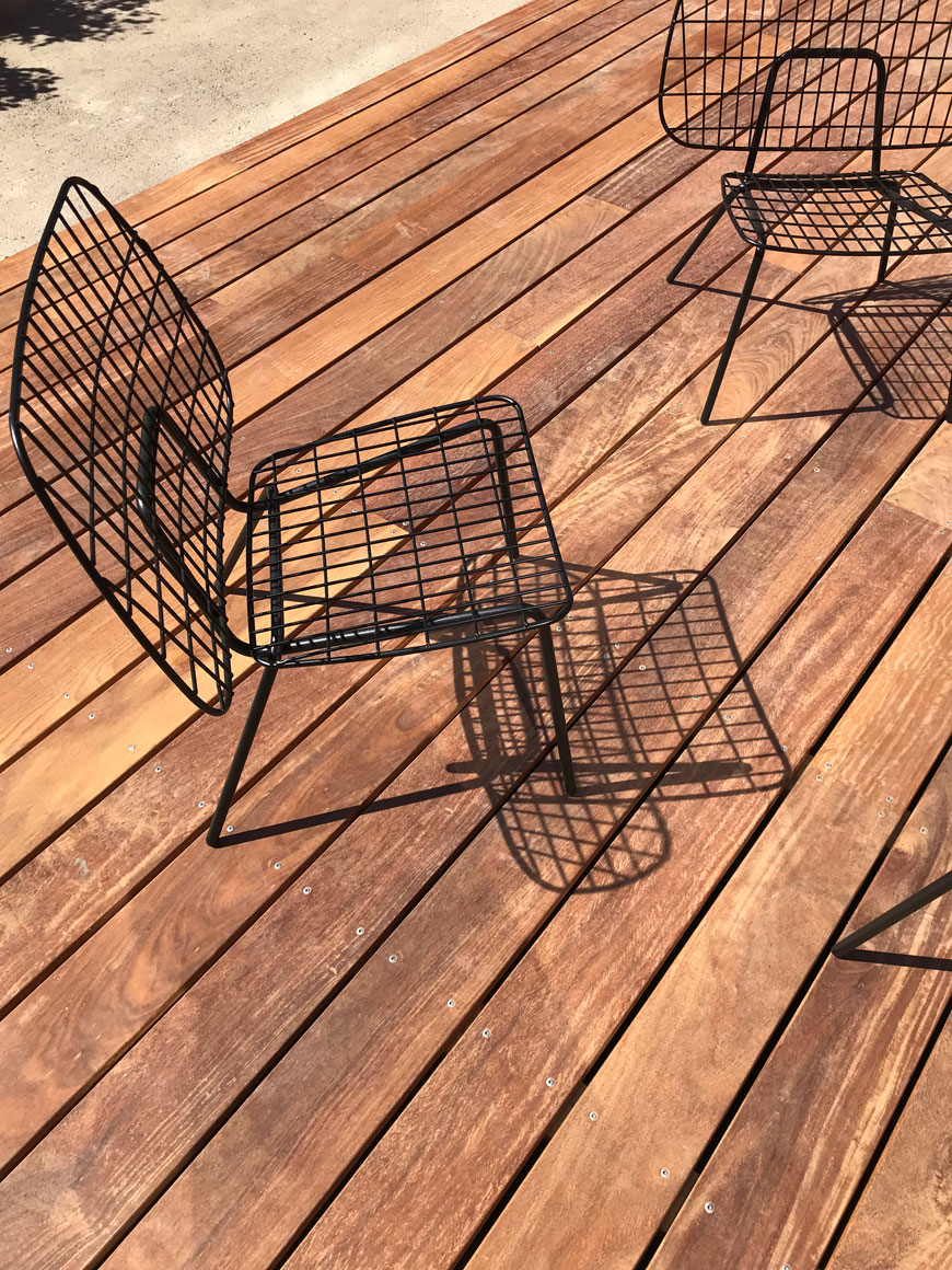WM String Lounge Chairs sit on an outdoor wooden deck at The Audo hotel in Copenhagen.