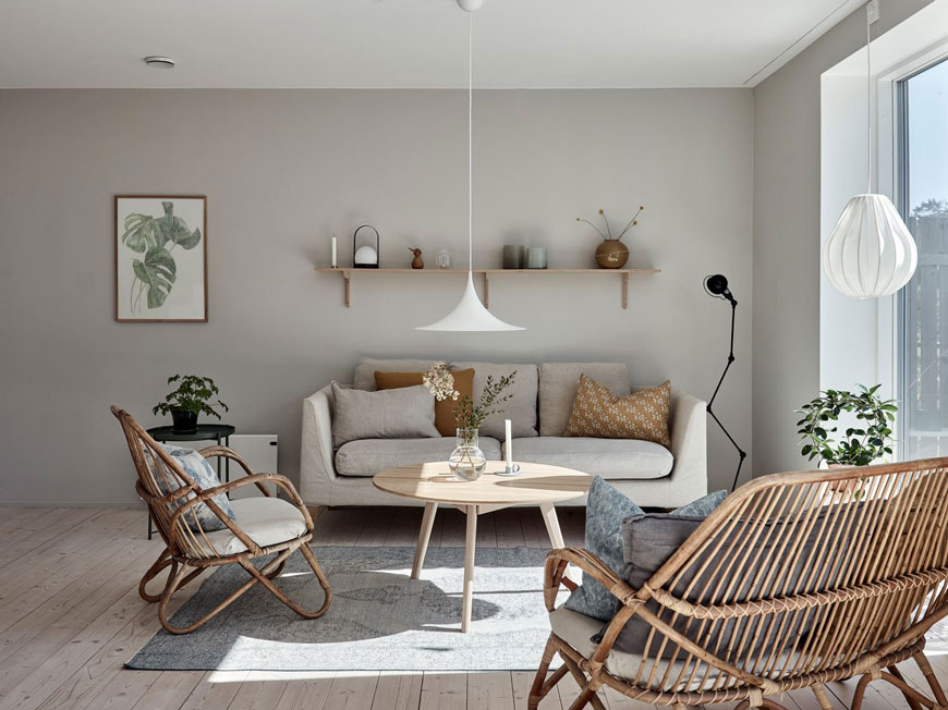 A light grey living room in an architect designed family home on the Swedish island of Brännö.