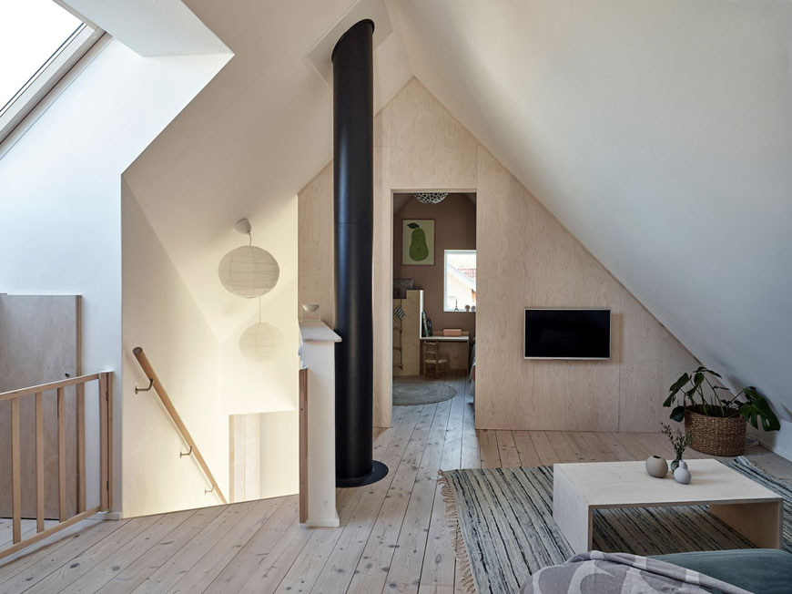A cosy snug area at the top of the stairs between the two bedrooms in the eaves of this Sweden island home on Brännö island.