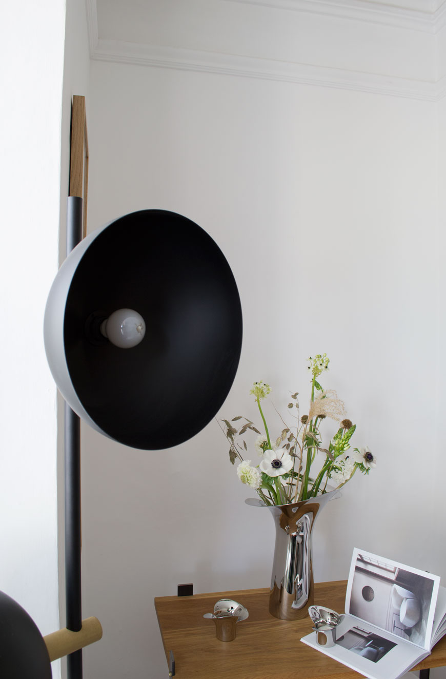 The black Studio Lamp floor designed by Handvärk in my white, Nordic inspired living room next to a Georg Jensen Bloom Botanica vase, filled with fresh, white spring flowers.