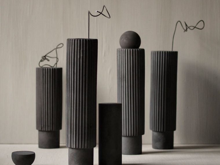 Tall black-brown ceramic Ripple vases created by Bergen based artist and designer Laurie Poast.