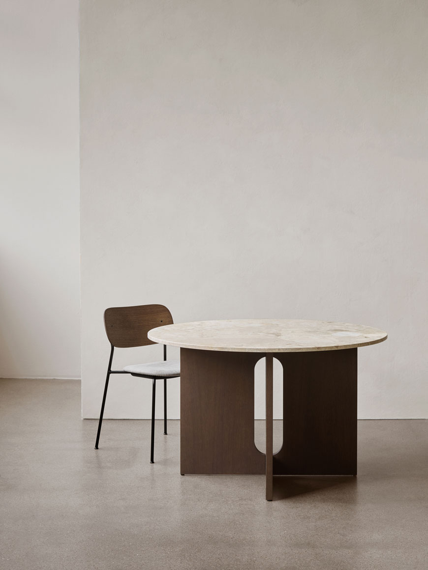 An update on the Androgyne side table designed by architect-designer Danielle Siggerund, the new Androgyne dining table features a Kunis Breccia mixed stone table top, polished to a high shine on top of a sculptural oak base.