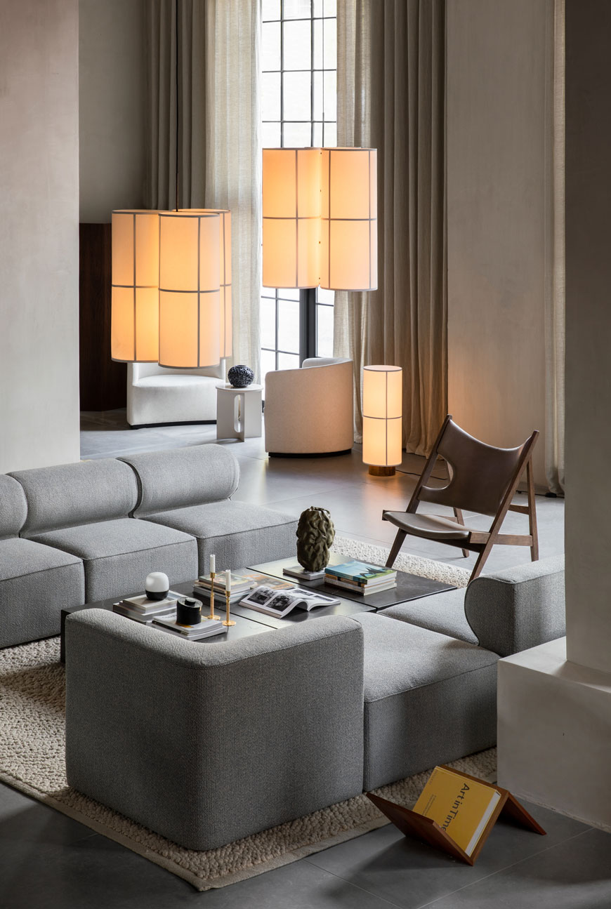 The open plan living space inside The Audo, Copenhagen, featuring furniture from the MENU Connected Spaces collection, including the rice paper inspired Hashira lighting collection designed by Norm Architects.