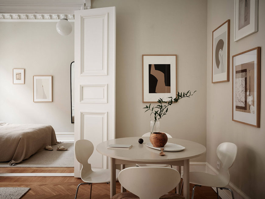 Warm, neutral tones are picked out in framed abstract art on the walls of this period Gothenburg home