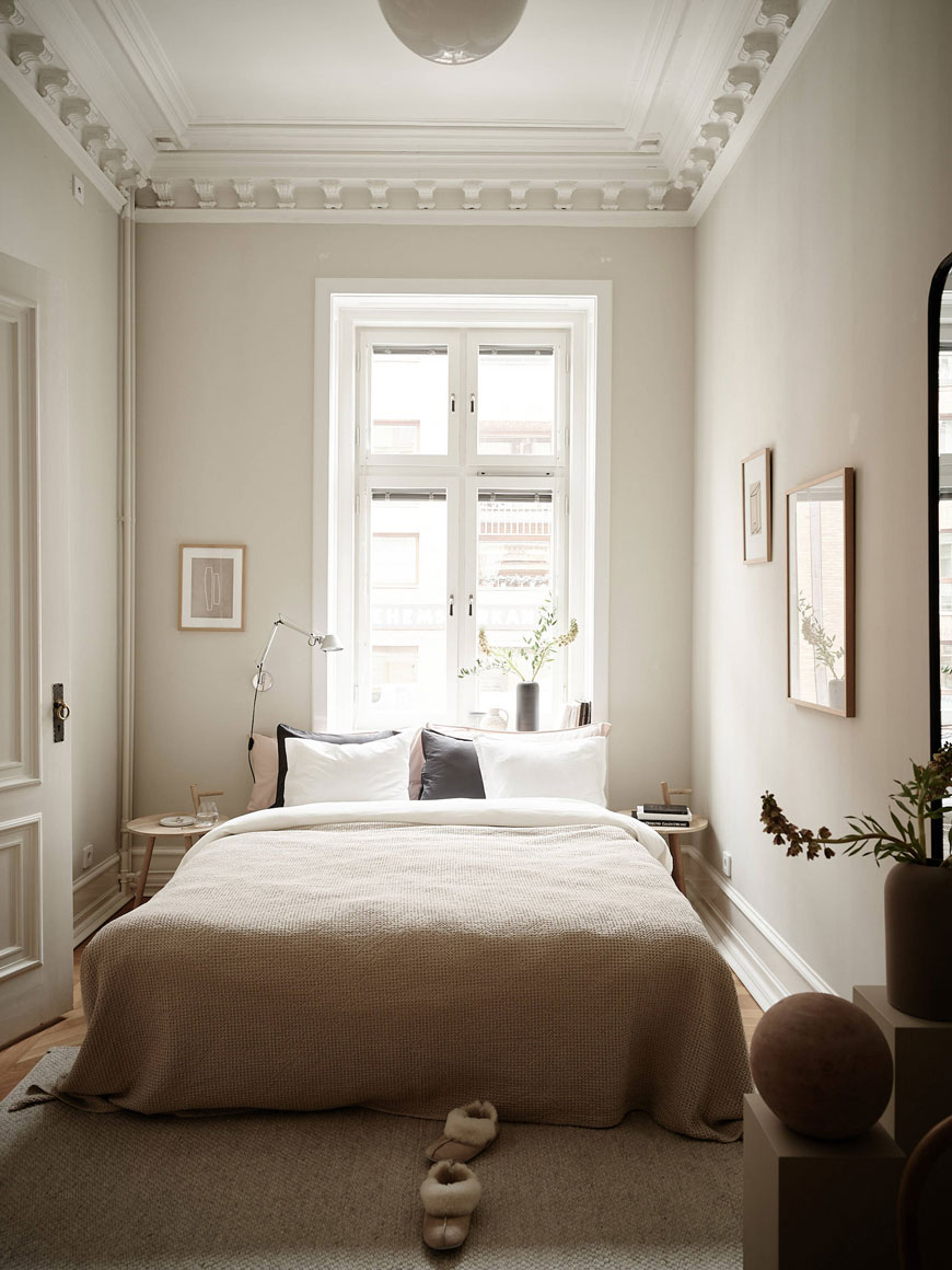 A calm and soothing soft grey bedroom inside this Swedish period home styled with contemporary design.