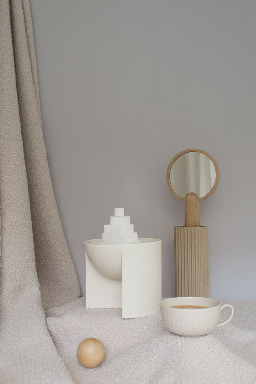 Minimal, tonal beige, cream and grey interior styling with boucle wool fabric against an eco-paint backdrop from Graphenstone Paint.