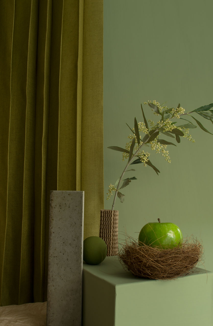 Tonal green on green contemporary interior styling using green linen, Graphenstone eco-paint in Olive and Kombu green and Hoxton porcelain tile from Mandarin Stone.